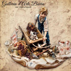 Porcellana di Capodimonte. Bimbo con carriola e cagnolini