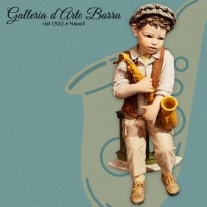 Porcellana artistica Sibania. Ragazzo suonatore di Jazz. Realismo puro