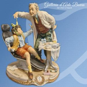 Porcellana di Capodimonte Dentista con Bambino Impaurito. Realismo puro